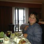Our daughter enjoying her baked potato from room service