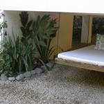 Hanging bed with hidden sleeping dog (manager's pet)