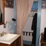 Joe's Room/Room 8: The sink area and the closet, with complimentary robes.