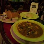 Amazing seafood soup in the restaurant with a side of Tortilla chips and the fixings