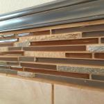 Glass tile trim in Indian Paintbrush bath