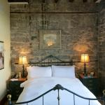Old stone wall in the bedroom