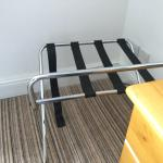 Broken luggage rack, no cupboards just hanging hook on the wall, cheap flat-pack pine bedside ta
