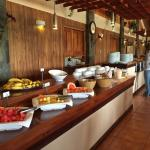 Photos of breakfast buffet (fruit, cereals, eggs, sausage, rice, breads, coffee and juices) and