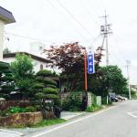 Bicycle garage and road leading to the ryokan