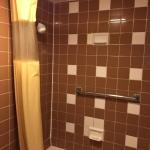 The bathroom has a newer shower curtain and rod. The sheets and pillows were clean and bed surpr