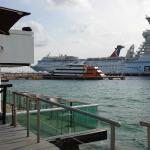 View from poolside of cruise ship docks