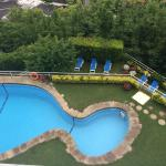 View of pool: sun loungers are the level below