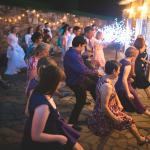 Dancing on their back patio behind the reception hall