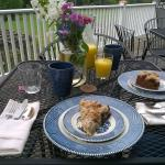 Typical breakfast setting on the deck overlooking the gardens. This coffee cake was only the sta