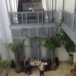 View from our room. Hotel  owner entertaining guests having breakfast. The Riad library abo