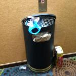 Overflowing Trash Can outside Elevator