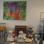 a bright, attractive painting in part of he breakfast area