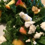Organic soft baby kale salad with fresh MI peaches, goat cheese, and pumpkin seed.
