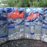 Water feature front of Hotel Gabion w/ recycled materials