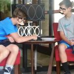 Kids at lobby coffee table as there were NO tables to sit at for breakfast
