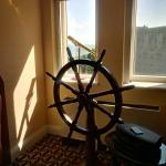 Ship's wheel and telescope inside the suite