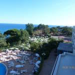 View From Our Balcony - The Grassed Area and Sun beds