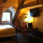 My delightful room at the top of the stairs at Auberge Place D'Armes. Photo by Meg McKenzie