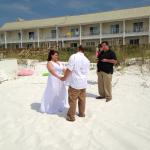 My husband and I got married right outside on the private beach! August 2014