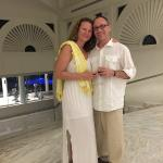 My wife and I behind the main lobby.  You can see the gym equipment (in the background)