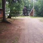 Drive past smaller cabins to office
