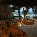 The beautiful view every evening from the restaurant...feet in the sand.