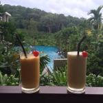 Enjoying Mango & Pineapple smoothies (fresh from one of the pool bars) - view from our balcony