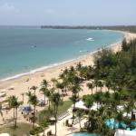 Amazing view from our room of Isla Verde Beach and Courtyard's pool.