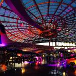 Evening shot of Red Bull Hangar 7 with colored lights