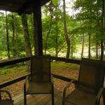 front porch of cabin, ideal for morning coffee & evening wine