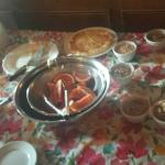 Breakfast buffet included small bowls of pre-poured cereal, quiche, grapefruit, and delicious ci