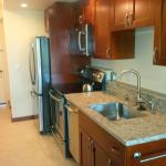 Renovated kitchen with full-sized refrigerator and range/oven