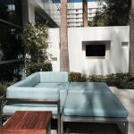 Private outdoor patio - couch and TV.
