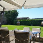 Restaurant Patio with a View of Siena & Impeccable Landscaping