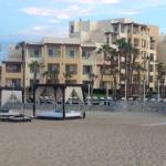 View to hotel from beach with beach beds - rent for $40/day or free if you paid for Ocean View r