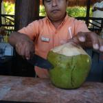 A picture of Juan, one of our favorite bartenders, making a rum drink from a coconut for me! He