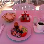 Breakfast (under a red umbrella)
