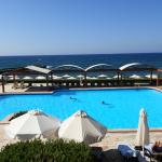 view over quiet pool and sea from room