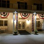 The front of the Bar Harbor Inn at night.