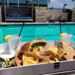 Roast beef and turkey sandwich poolside