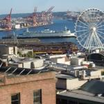 Ferris wheel and Washington State Ferry seen from the rooftop.