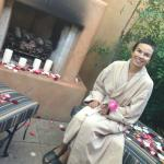 Private massage suite with an outdoors rain and Vichy shower and relax area