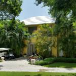 Front of the villa with the golf cart and bicycle parking