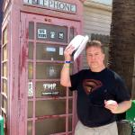 A phone booth near Smyrna Beach makes for a great photo op, but not for a quick change, Clark.