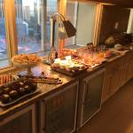 Breakfast in the gold lounge. Fresh selection. Fresh juices. Two kinds of eggs and sausage and b