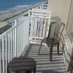 Every room is oceanfront and has a small balcony with two chairs and a small table.