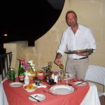 Brian - the wonderful manager - preparing dinner at our terrace !