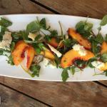 Tasty peach and Arugula salad with blue cheese