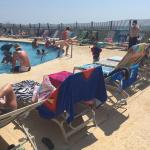 Crowded pools, all are like this everyday. Towels used to reserve seating for those not present.